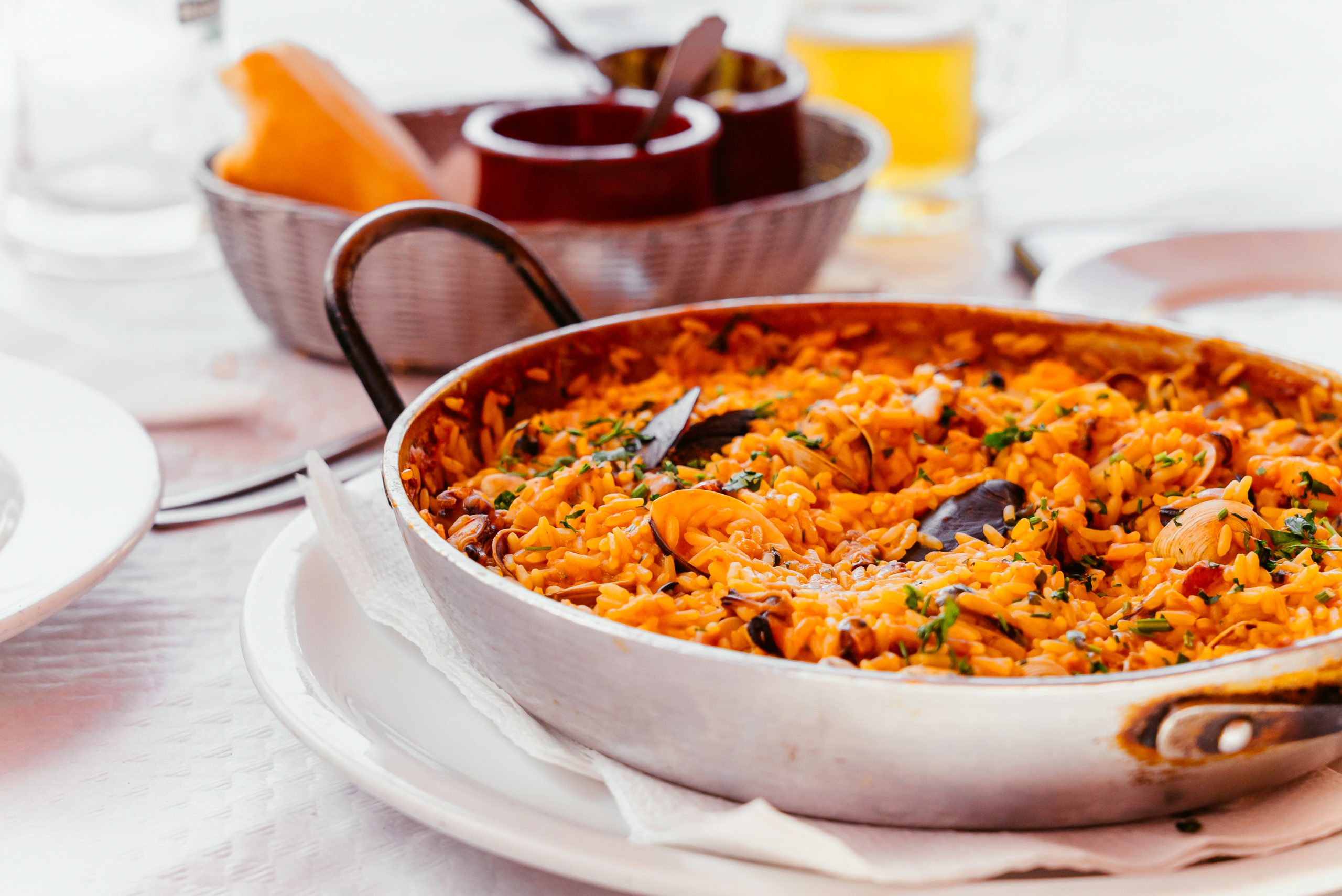 spanish seafood paella with mussels shrimps etc in steel paella pan canary islands cousine in small family restaurant scaled - Los mejores mariscos para una buena paella